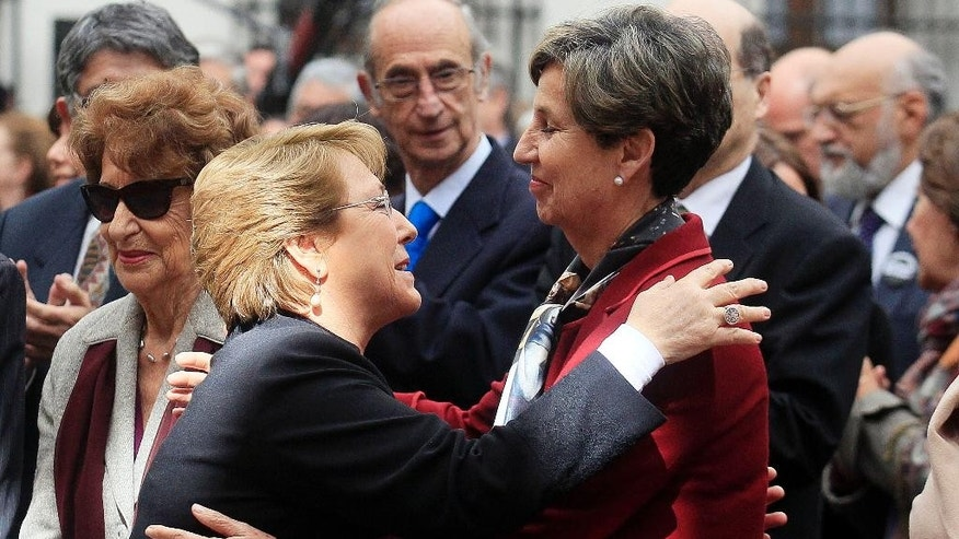 Chile's President Michelle Bachelet, left, greets Isabel Allende, head of the Senate and daughter of former President Salvador Allende, before a ceremony marking the 41st anniversary of Chile's 1973 military coup, at La Moneda presidential palace in Santiago, Chile, Thursday, Sept. 11, 2014. The coup toppled Chilean President Salvador Allende and began the military dictatorship of Gen. Augusto Pinochet. (AP Photo/Luis Hidalgo)