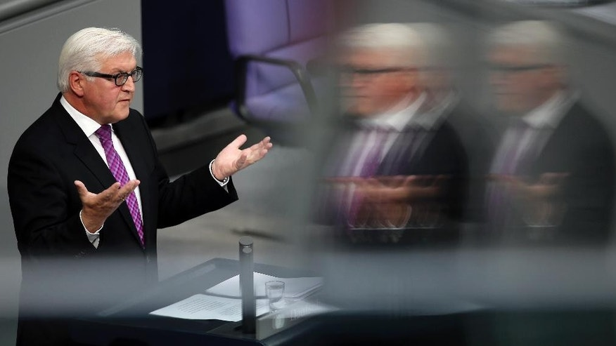 German Foreign Minister Frank-Walter Steinmeier gestures during his speech as part of a meeting of the German parliament, Bundestag, in Berlin, Germany, Thursday, Sept. 11, 2014. (AP Photo/Michael Sohn)