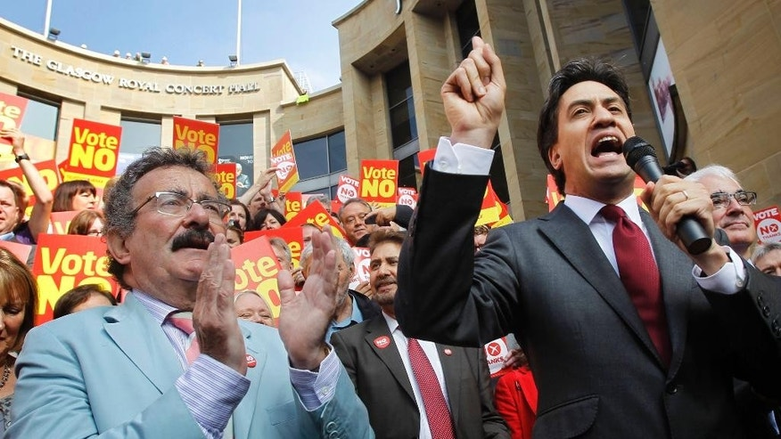 Labour leader Ed Miliband, right, campaigns with TV personality, Robert Winston, on Buchanan Street in Glasgow, Scotland, as the campaign ahead of the Scottish independence referendum intensifies, Thursday Sept. 11, 2014. The referendum on Scotland's independence takes place on September 18. (AP Photo/PA, Danny Lawson)  UNITED KINGDOM OUT  NO SALES  NO ARCHIVE
