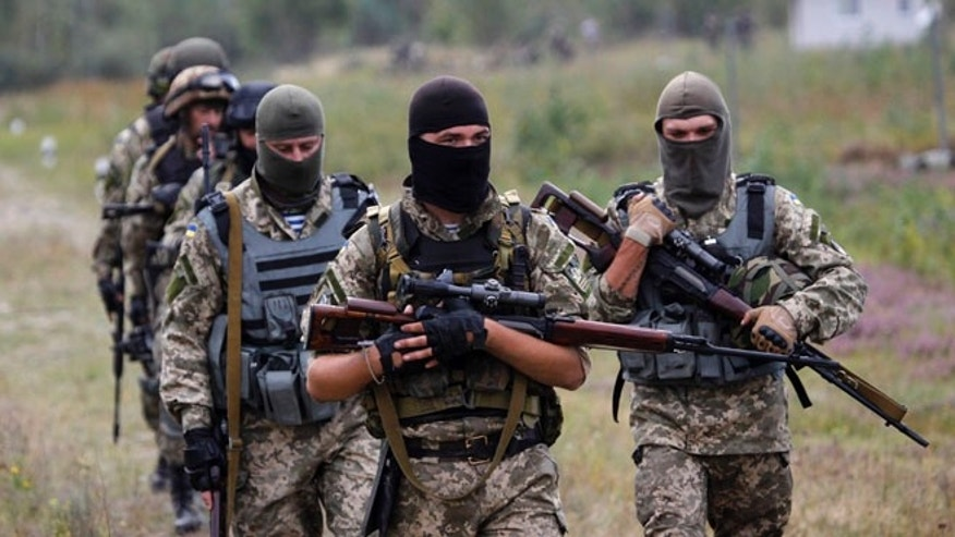 September 11, 2014: Ukrainian soldiers take part in a military exercise west of Kiev (AP)
