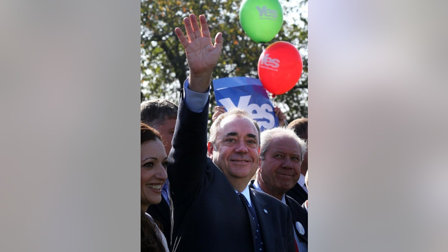 """Scotland's First Minister, Alex Salmond, waves to the crowd during a visit to Edinburgh campaigning as """"Team Scotland against Team Westminster"""", Wednesday Sept. 10, 2014. In a rare display of cross-party unanimity, Conservative Prime Minister, David Cameron, Labour leader Ed Miliband and Liberal Democrat chief Nick Clegg all pulled out of a weekly House of Commons question session in London to make a late campaign dash to Scotland as polls suggest the two sides are neck-and-neck ahead of the Sept. 18 independence referendum. (AP Photo/PA, David Cheskin)  UNITED KINGDOM OUT  NO SALES  NO ARCHIVE"""