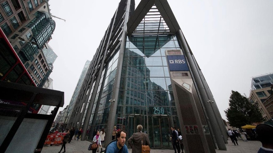 An exterior view shows offices of Royal Bank of Scotland (RBS) in the City of London, Thursday, Sept. 11, 2014. In a blow to the Scottish independence campaign, three top financial groups, including the Royal Bank of Scotland, say they will move headquarters to England should Scots vote to break away from the United Kingdom.  RBS, which has been based in Scotland since 1727, said Thursday it has drawn up contingency plans because being based in an independent Scotland would create uncertainties that could hurt its business and customers.  (AP Photo/Matt Dunham)