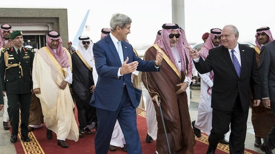 U.S. Secretary of State John Kerry, third right, speaks with Joseph W. Westphal U.S. Ambassador to Saudi Arabia, right, and Saudi Foreign Minister Prince Saud al-Faisal, second right, upon his arrival at the Royal Terminal of the King Abdulaziz International Airport in Jiddah, Saudi Arabia, Thursday, Sept. 11, 2014. Kerry arrived in Saudi Arabia, on Thursday to try to persuade officials from across the Mideast and Turkey to put aside longstanding rivalries to more vigorously pursue the Islamic State — and, in doing so, ward off a threat that has put the entire region at risk. (AP Photo/Brendan Smialowski, Pool)
