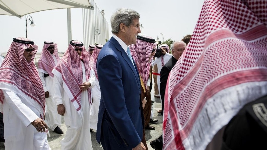 U.S. Secretary of State John Kerry arrives at the Royal Terminal of the King Abdulaziz International Airport in Jiddah, Saudi Arabia, Thursday, Sept. 11, 2014. Kerry arrived in Saudi Arabia, on Thursday to try to persuade officials from across the Mideast and Turkey to put aside longstanding rivalries to more vigorously pursue the Islamic State — and, in doing so, ward off a threat that has put the entire region at risk. (AP Photo/Brendan Smialowski, Pool)