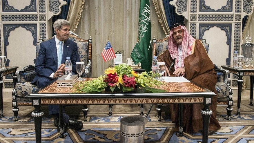 U.S. Secretary of State John Kerry meets with Saudi Foreign Minister Prince Saud al-Faisal at the Royal Terminal of the King Abdulaziz International Airport in Jiddah, Saudi Arabia, Thursday, Sept. 11, 2014. Kerry arrived in Saudi Arabia, on Thursday to try to persuade officials from across the Mideast and Turkey to put aside longstanding rivalries to more vigorously pursue the Islamic State — and, in doing so, ward off a threat that has put the entire region at risk. (AP Photo/Brendan Smialowski, Pool)