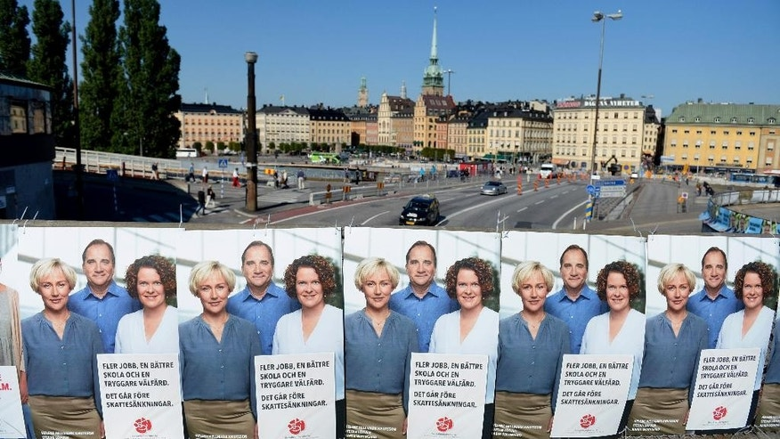 General election posters for the Social Demokrats party are displayed Thursday Sept. 11, 2014 in central Stockholm. Sweden will head to the polls Sunday, in an election that is expected to be closely fought. (AP Photo/TT, Jessica Gow)  SWEDEN OUT