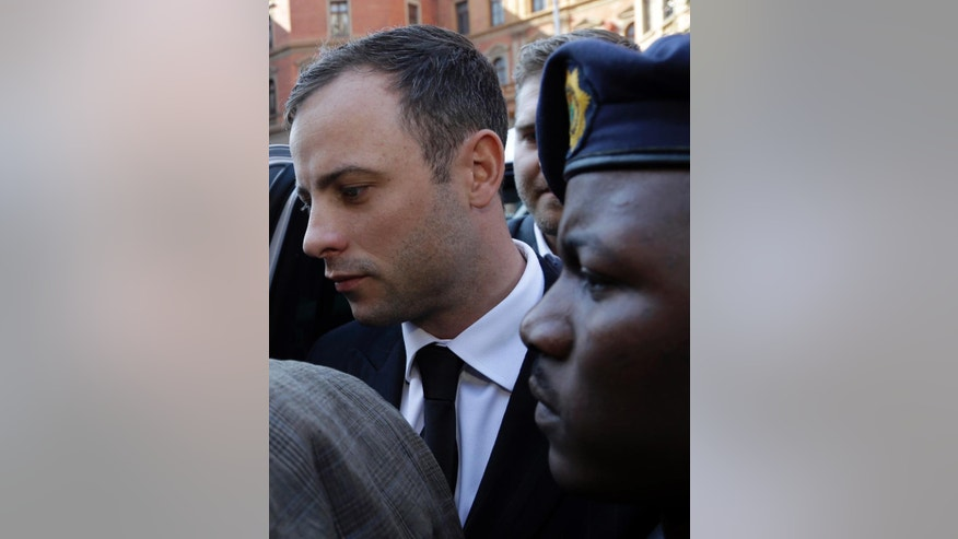 Oscar Pistorius arrives at the high court in Pretoria, South Africa, Friday, Sept. 12, 2014. Presiding Judge Thokozile Masipa is expected to announce her verdict in Pistorius' murder trail after scrutinizing evidence Thursday and Friday given by 37 witnesses in a court transcript running to thousands of pages in a drama that has played out over six months. (AP Photo/Themba Hadebe)