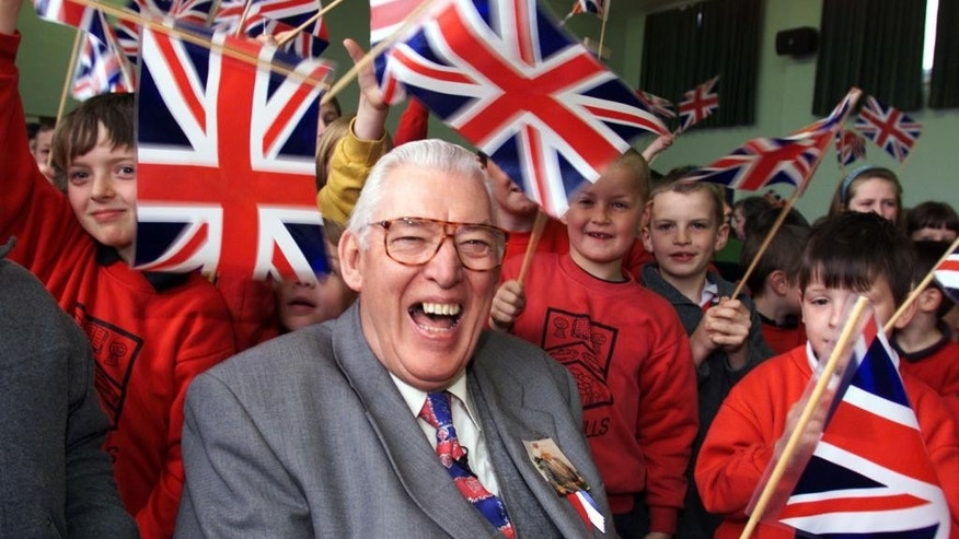 FILE - In this April 20, 1999 file photo former Democratic Unionist Party leader Ian Paisley laughs as he poses for a photo with school children. Paisley the fiery Protestant leader has died in Northern Ireland aged 88  his wife Eileen said Friday Sept. 12, 2014. (AP Photo/PA, Paul Faith) UNITED KINGDOM OUT