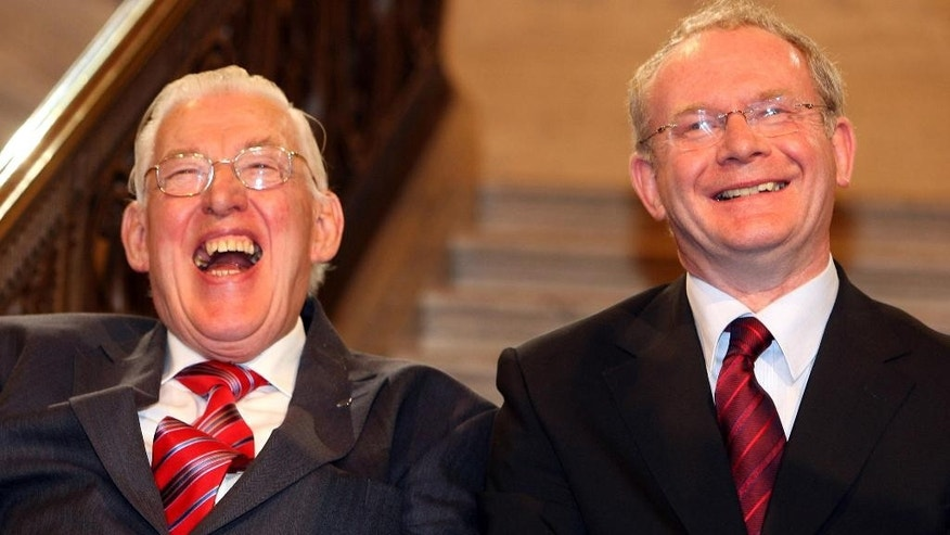 FILE - In this May 8, 2007 file photo former Democratic Unionist Party leader  Ian Paisley, left, and Martin McGuinness laugh during a photo call in Belfast, Northern Ireland. Paisley the fiery Protestant leader has died in Northern Ireland aged 88  his wife Eileen said Friday Sept. 12, 2014. (AP Photo/PA, Paul Faith) UNITED KINGDOM OUT