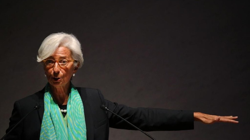 IMF chief Christine Lagarde delivers a speech during the World Assembly for Women (WAW! Tokyo 2014) at Japan Business Federation in Tokyo, Friday, Sept. 12, 2014.  The head of the International Monetary Fund says equal opportunities and empowerment of women are crucial for driving a stronger global recovery, and for revitalizing Japan.(AP Photo/Eugene Hoshiko)