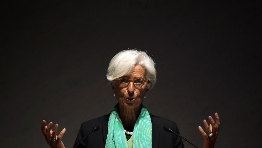 IMF chief Christine Lagarde delivers a speech during the World Assembly for Women (WAW! Tokyo 2014) at Japan Business Federation in Tokyo, Friday, Sept. 12, 2014.  The head of the International Monetary Fund says equal opportunities and empowerment of women are crucial for driving a stronger global recovery, and for revitalizing Japan. (AP Photo/Eugene Hoshiko)