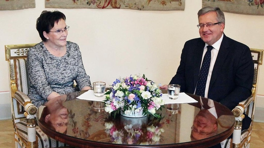 Polish President Bronislaw Komorowski, right, meets the speaker of the parliament Ewa Kopacz at Belweder palace in Warsaw, Poland, Friday, Sept. 12, 2014. Komorowski accepted the resignation of Prime Minister Donald Tusk's pro-market government on Thursday. Tusk is to be succeeded by Ewa Kopacz. (AP Photo/Czarek Sokolowski)