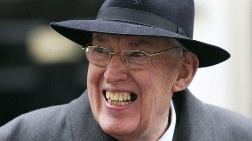 March 22, 2007: Rev. Ian Paisley, Leader of the Democratic Union Party, smiles as he speaks to the press as he leaves 11 Downing Street after a meeting on the Northern Ireland budget with British Chancellor Gordon Brown in London. (AP/Sang Tan, File)