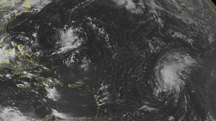 This NOAA satellite image taken Friday, Sept. 12, 2014, at 10:45 a.m. EDT shows a tropical disturbance over the western Bahamas and southern Florida with rain and thunderstorms. This system will move into the Gulf of Mexico. Tropical Storm Edouard continues to strengthen and move to the northwest and will continue to strengthen. A tropical wave moves westward across the central Caribbean Sea with rain showers and thunderstorms. (AP Photo/Weather Underground)