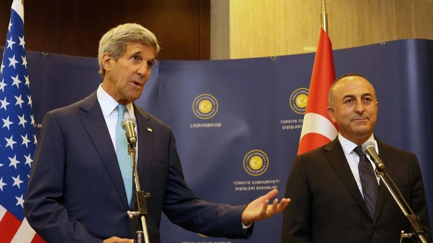 Turkey's Minister of Foreign Affairs Mevlut Cavusoglu, right, and U.S. Secretary of State John Kerry speak to the media before a meeting in Ankara, Turkey, Friday, Sept. 12, 2014. Kerry arrived in Saudi Arabia, on Thursday to try to persuade officials from across the Mideast and Turkey to put aside longstanding rivalries to more vigorously pursue the Islamic State — and, in doing so, ward off a threat that has put the entire region at risk. Kerry meets with Turkish leader on Friday. (AP Photo/Burhan Ozbilici)