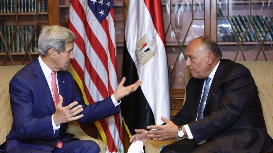 U.S. Secretary of State John Kerry, left, talks to Egypt's Foreign Minister Sameh Shukri, in Cairo, Egypt, Saturday, Sept. 13, 2014. Kerry arrived in Cairo for a short visit of less than a day to discuss how Egypt can help in the fight against the Islamic State group. He has been on a regional trip to garner support for President Barack Obama's initiative to assemble a coalition of nations willing to go after the militant group. Kerry heads to Paris next for a meeting on how to support Iraq in its fight against the Islamic State group, which holds large parts of Iraq and Syria. (AP Photo/Amr Nabil)