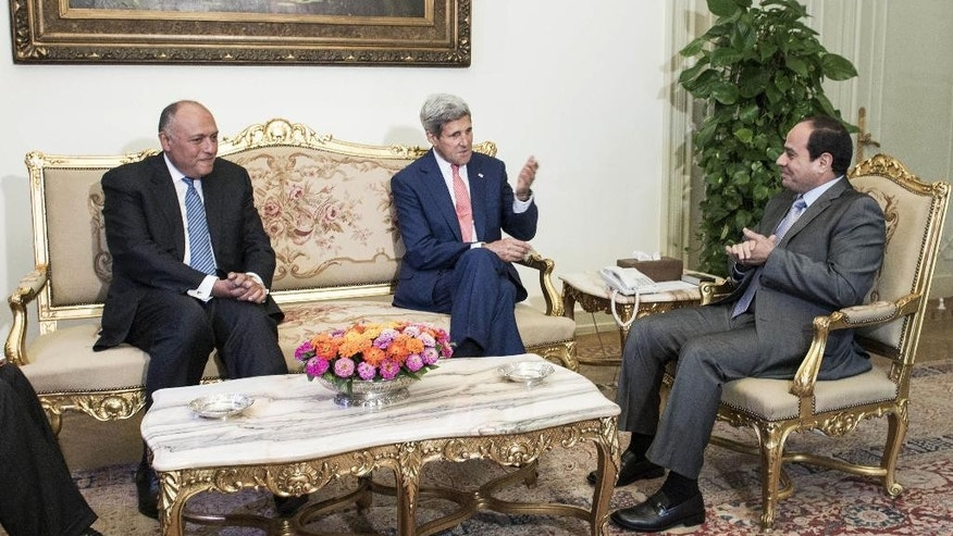 Egyptian Foreign Minister Sameh Shukri, left, and President Abdel-Fattah el-Sissi, right, listen to U.S. Secretary of State John Kerry before a meeting at the presidential palace in Cairo, Egypt, Saturday, Sept. 13, 2014. Kerry arrived in Cairo for a short visit of less than a day to discuss how Egypt can help in the fight against the Islamic State group. He has been on a regional trip to garner support for President Barack Obama's initiative to go assemble a coalition of nations willing to go after the militant group. Kerry heads to Paris next for a meeting on how to support Iraq in its fight against the Islamic State group, which holds large parts of Iraq and Syria. (AP Photo/Brendan Smialowski, Pool)