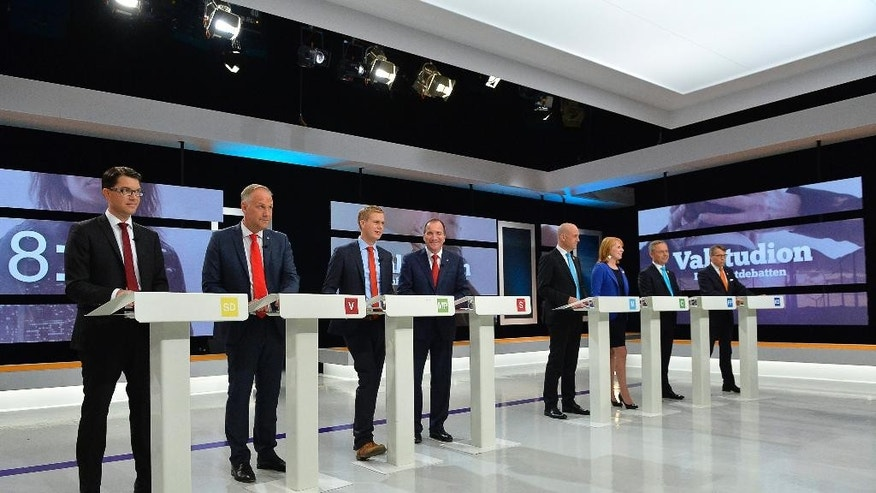 Swedish party leaders take part in an election debate broadcast by the SVT public service television in Stockholm, Friday,  Sept. 12, 2014. From left Jimmie Akesson Sweden Democrats, Jonas Sjostedt Left party, Gustav Fridolin, Green party, Stefan Lofven Social democrat, Fredrik Reinfeldt Moderate party, Annie Loof Center party,  Jan Björklund Liberal party and Goran Hagglund Christian Democrats. (AP Photo/TT, Anders Wiklund) SWEDEN OUT