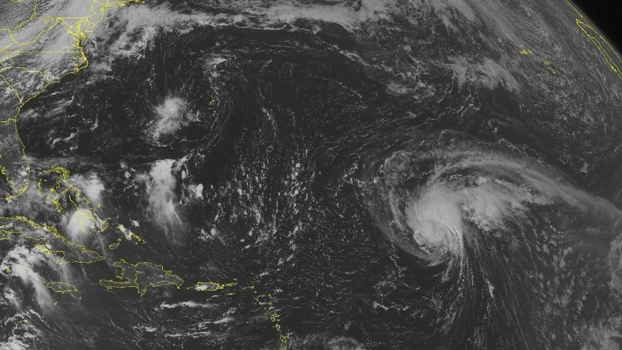 This NOAA satellite image taken Saturday, Sept. 13, 2014, at 1:45 p.m. EDT shows  mass of clouds over the Central Atlantic Basin associated with Tropical Storm Edouard. Scattered clouds are present over the Bahamas, Cuba, and the northwestern Caribbean Basin. Widely scattered clouds are occurring over the eastern Caribbean Basin. (AP Photo/Weather Underground)