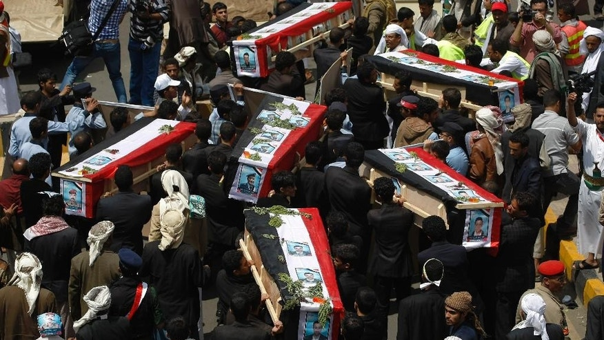 Hawthi Shiite protesters carry coffins of fellow protesters who were killed in recent clashes with Yemeni police, during their funeral procession in Sanaa, Yemen, Friday, Sept. 12, 2014. Yemeni officials said Thursday that security forces have gone on high alert, fearing that al-Qaida members are streaming into the capital, where a Shiite rebel group's demonstrations have turned deadly. The reports of al-Qaida infiltration came as the government sought international mediation in reaching a peaceful resolution to its conflict with the Shiite rebel group known as the Hawthis, which clashed with police in the capital Sanaa earlier this week. (AP Photo/Hani Mohammed)