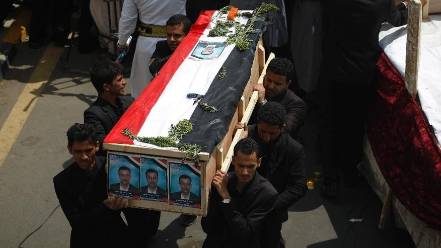 Hawthi Shiite protesters carry the coffin of one of their fellow protesters who were killed in recent clashes with Yemeni police, during their funeral procession in Sanaa, Yemen, Friday, Sept. 12, 2014. Yemeni officials said Thursday that security forces have gone on high alert, fearing that al-Qaida members are streaming into the capital, where a Shiite rebel group's demonstrations have turned deadly. The reports of al-Qaida infiltration came as the government sought international mediation in reaching a peaceful resolution to its conflict with the Shiite rebel group known as the Hawthis, which clashed with police in the capital Sanaa earlier this week. (AP Photo/Hani Mohammed)