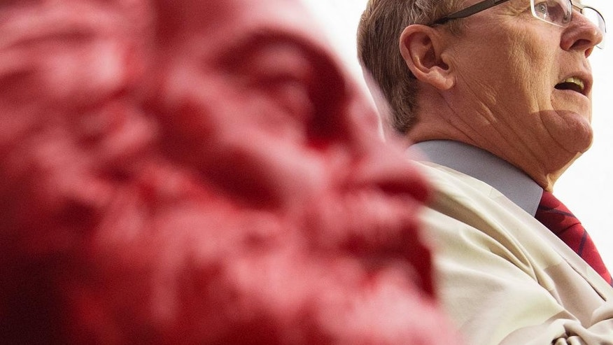 Bodo Ramelow, top candidate of German party 'Die Linke' (The Left) for the parliament elections in Thuringia  state delivers a speech behind a red Karl Marx bust during an election campaign   in Erfurt,  Germany, Friday, Sept.12, 2014. A quarter-century after the Berlin Wall fell, an election this weekend may show whether Germany is ready for its first state governor from the party descended from East Germany's communist rulers. The opposition Left Party hopes to end the 24-year grip of Chancellor Angela Merkel's conservatives on the governor's office in eastern Thuringia state Sunday. (AP Photo/Jens Meyer)