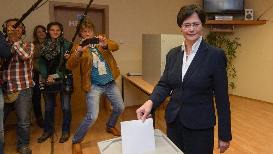 Thuringia governor and top candidate of Chancellor Angela Merkel's Christian Democratic Union party, Christine Lieberknecht, casts her vote during regional state elections in Ramsla, eastern Germany, Sunday Sept. 14, 2014.  In Thuringia, polls show Chancellor Angela Merkel's conservatives could face a threat to their 24-year hold on the governor's office from a three-way alliance led by the Left Party, which has ex-communist roots. (AP Photo/dpa, Candy Welz)