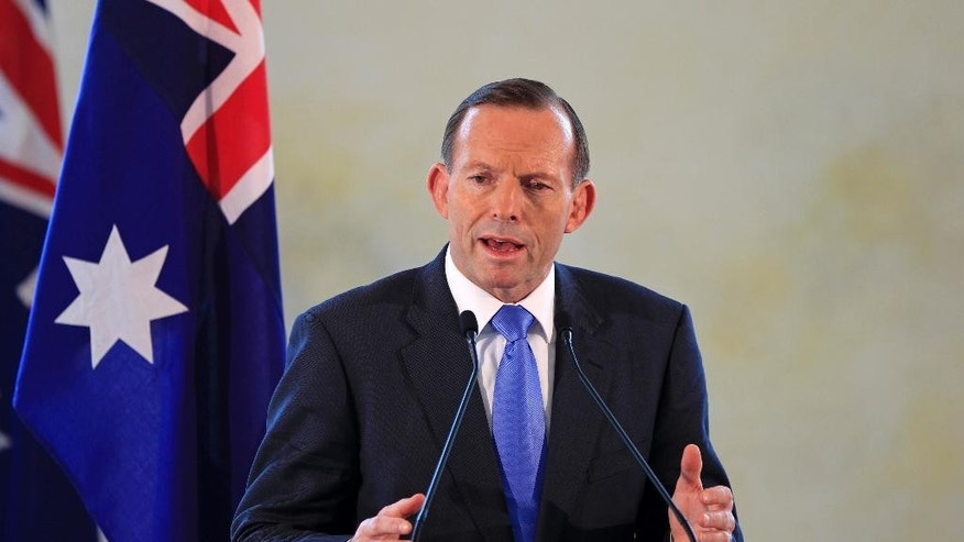 FILE - Australian Prime Minister Tony Abbott speaks during a joint press conference with his Malaysian counterpart Najib Razak after a meeting in Putrajaya, Malaysia, in this Saturday, Sept. 6, 2014 file photo. Australia is preparing to contribute up to 10 military aircraft to the increasingly aggressive campaign against the Islamic State extremists in Syria and Iraq. Abbott said Sunday Sept. 14, 2014 in a statement that Australia was responding to a formal request from the United States for specific contributions to the international coalition. (AP Photo/Lai Seng Sin, File)