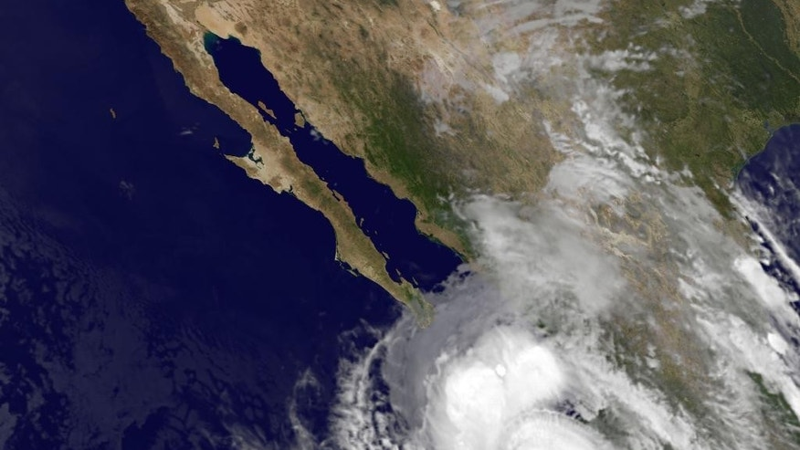 This satellite image provided by NOAA shows category four Hurricane Odile taken at 5:45 a.m. EDT Sunday Sept. 14, 2014. The rapidly strengthening Hurricane Odile intensified Saturday night and appeared headed for a possible close brush with the southern end of Mexico's Baja California peninsula. At 5 a.m. EDT Odile had maximum sustained winds of 135 mph and was moving north-northwest at 15 mph. (AP Photo/NOAA)