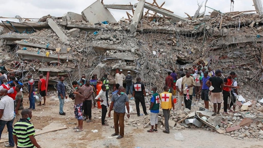 FILE-In this file photo taken on Saturday, Sept. 13, 2014, Rescue workers search for survivors in the rubble of a collapsed building belonging to the Synagogue Church of All Nations in Lagos, Nigeria. Rescue workers have recovered 46 bodies and rescued 130 survivors from a collapsed shopping mall and guesthouse at the campus of renowned Nigerian preacher T.B. Joshua's Synagogue Church of All Nations, the West African nation's emergency agency said Monday, Sept. 15, 2014. (AP Photo/Sunday Alamba, File)
