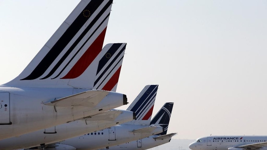 Air France planes are parked on the tarmac at Paris Charles de Gaulle airport, in Roissy, near Paris, Monday, Sept. 15, 2014. Pilots for Air France have kicked off a weeklong strike, angry that the airline is shifting jobs and operations to a low-cost carrier to better keep up with competition. (AP Photo/Christophe Ena)