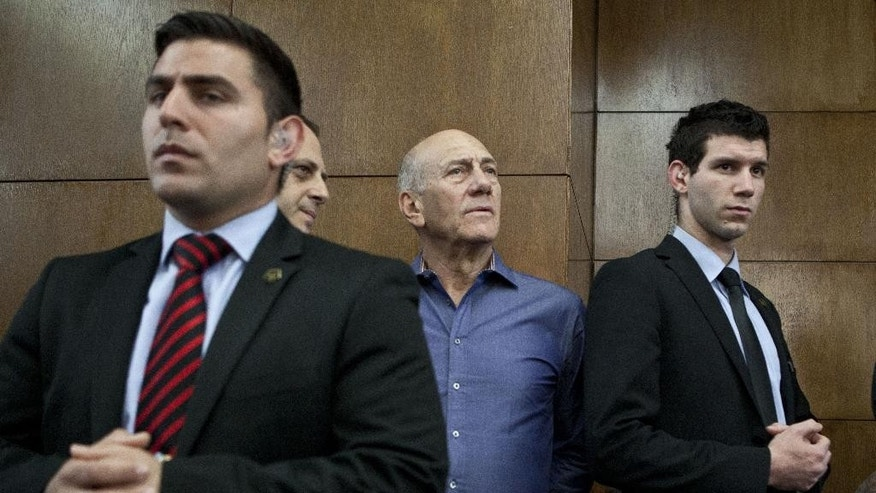 FILE - In this Monday, March 31, 2014 file photo, Former Israeli Prime Minister Ehud Olmert attends a hearing at Tel Aviv's District Court. Israel's Supreme Court on Monday postponed the start of Olmert's prison sentence pending appeal on his conviction on corruption charges. (AP Photo/Dan Balilty, File)
