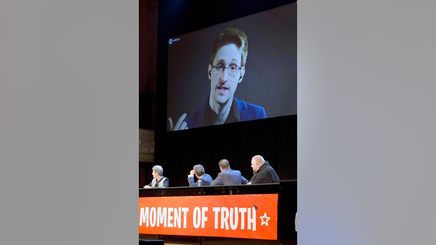 Sept. 15, 2014 - Former NSA systems analyst turned leaker Edward Snowden appears via video link from Russia to hundreds at the Auckland, New Zealand Town Hall.  Snowden says the NSA is collecting mass surveillance data on New Zealanders through its XKeyscore program and has set up a facility to tap into vast amounts of data.