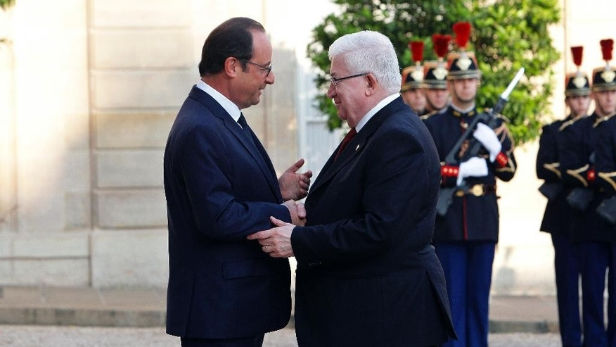 France's President Francois Hollande, left, talks with Iraqi counterpart Fouad Massoum ahead of a conference with U.S. Secretary of State John Kerry, French President Francois Hollande and diplomats from around the world, at the Elysee Palace, in Paris, Monday, Sept. 15, 2014. (AP Photo/Thibault Camus)