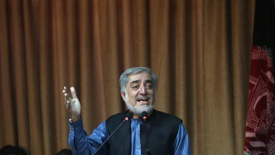 FILE - In this Monday, Sept. 8, 2014 file photo, Afghan presidential candidate and former Foreign Minister Abdullah Abdullah speaks during a news conference in Kabul, Afghanistan. The ballot counting in Afghanistan's five-month--long presidential election is finished, but as negotiations continue over the country's future political power structure, many here are asking: Does my vote even count? The two men now jockeying for presidential powers in secretive negotiations are Abdullah and former Finance Minister Ashraf Ghani Ahmadzai. (AP Photo/Massoud Hossaini, File)