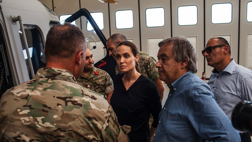 Sept. 15, 2014 - Actress Angelina Jolie-- Special Envoy for UN High Commission for Refugees-- listens to officers in the Maltese military discuss rescue at sea operations for refugees at a military base in Valetta, Malta. Since the start of 2014, more than 2,500 asylum seekers have perished trying to cross the Mediterranean.