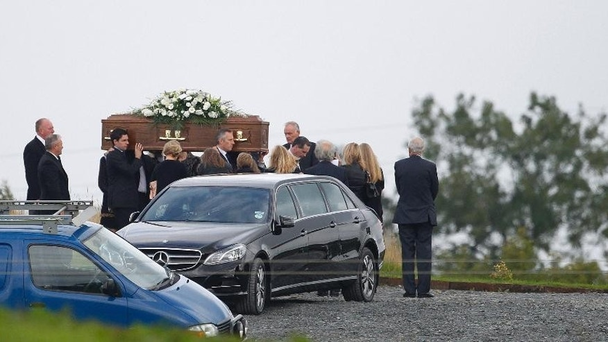 Ian Paisley jnr, centre left, carries the coffin of his father Ian Paisley for burial at Ballygowan Free Presbyterian church, Ballygowan, Northern Ireland, Monday, Sept. 15, 2014.  The funeral of Ian Paisley, the former Democratic Unionist Party leader and first minister of Northern Ireland, took place Monday, He was buried following a private funeral service at his family home in east Belfast. Dr Paisley, who stepped down from politics in 2008, passed away on Friday following a short illness aged 88. (AP Photo/Peter Morrison)