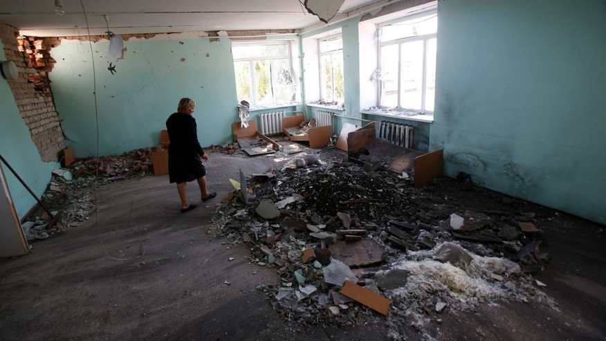 Sept. 15, 2014 -Teacher shows the damage caused to her shell-hit kindergarten in Novosvitlivka, eastern Ukraine. The village was severely damaged during fighting between government troops and the separatist rebels that eventually took control there in late August.