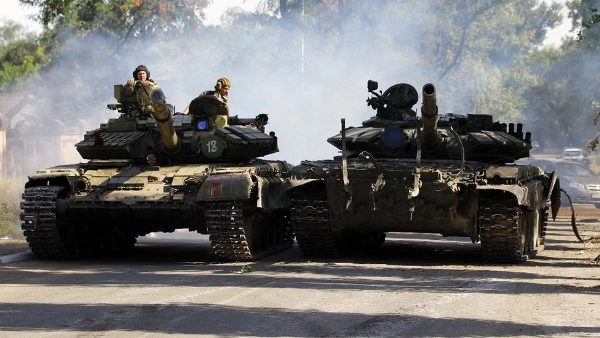 Sept. 14, 2014 - A Pro-Russian rebel tank in Luhansk, eastern Ukraine. Shelling killed 6 people and wounded 15 others in the rebel stronghold of Donetsk, the city council said -- the worst reported violence since a cease-fire between Russian-backed rebels and Ukrainian troops took effect on Sept. 5.