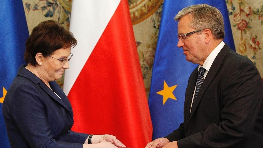 Poland's President Bronislaw Komorowski, right, appoints parliament speaker Ewa Kopacz to be the next prime minister and gives her the task of assembling the new cabinet in Warsaw, Poland, Monday, Sept. 15, 2014. Kopacz succeeds Donald Tusk, who resigned as government leader after being chosen to head the European Council. (AP Photo/Czarek Sokolowski)
