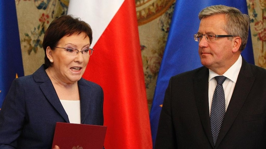Poland's President Bronislaw Komorowski, right, attends a ceremony, where he appointed parliament speaker Ewa Kopacz to be the next prime minister and tasked her with forming a new government in Warsaw, Poland, Monday, Sept. 15, 2014. Kopacz succeeds Donald Tusk, who resigned as government leader after being chosen to head the European Council. (AP Photo/Czarek Sokolowski)