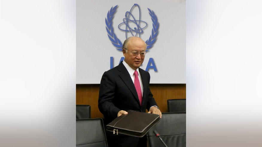 Director General of the International Atomic Energy Agency, IAEA, Yukiya Amano of Japan waits for the start of the IAEA board of governors meeting at the International Center in Vienna, Austria, Monday, Sept. 15, 2014. (AP Photo/Ronald Zak)