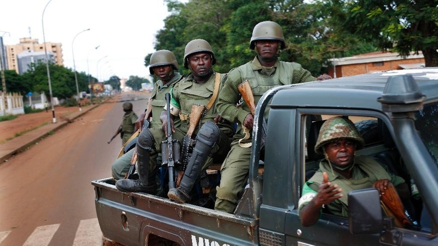 FILE-In this file photo taken on Thursday, May 29, 2014, African Union MISCA  troops from Cameroon patrol in Bangui, Central African Republic.  The United Nations took over a regional African peacekeeping mission in Central African Republic on Monday, Sept. 15,  nine months after sectarian violence erupted that has left at least 5,000 people dead and has forced tens of thousands of Muslims to flee into exile in neighboring countries. (AP Photo/Jerome Delay,File)