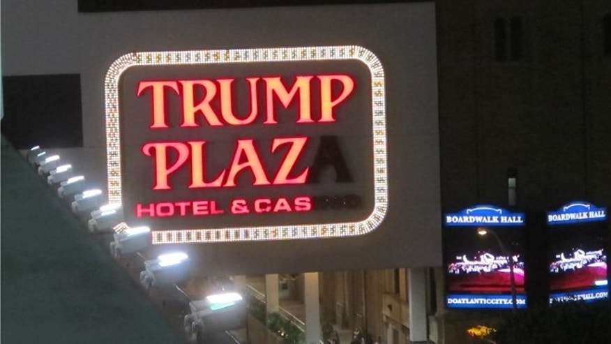 This Sept. 10, 2014, photo shows burned-out lights in the illuminated facade of Trump Plaza Hotel & Casino in Atlantic City, N.J. Trump Plaza is closing on Sept. 16, 2014, the fourth Atlantic City casino to go out of business so far this year. (AP Photo/Wayne Parry)