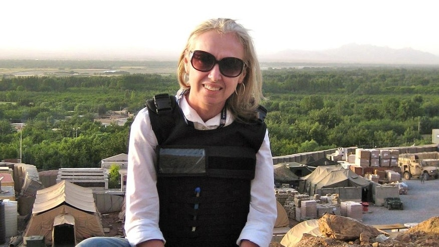 This undated 2009 photo shows journalist Lynne O'Donnell in Kandahar province, Afghanistan. O'Donnell, a foreign correspondent who has covered major stories throughout the Middle East and Asia for two decades, has been named Kabul bureau chief for The Associated Press, leading the agency's coverage of Afghanistan at a time of transition and turmoil. The appointment was announced on Tuesday, Sept. 16, 2014 by Ian Phillips, AP's Middle East news director, and Dan Perry, the regional editor for text. (AP Photo/Courtney Body)
