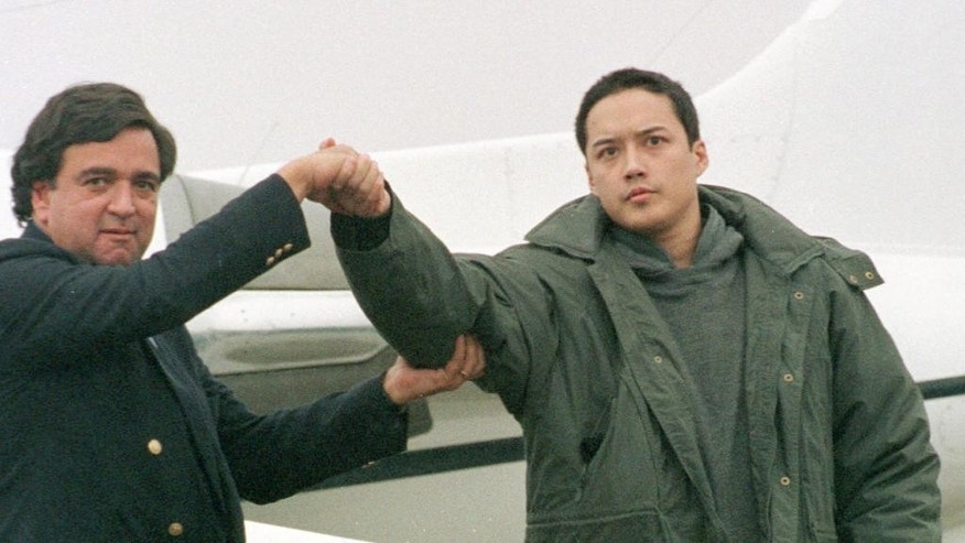 FILE - In this Nov. 27, 1996 file photo, American Evan C. Hunzik, right, shakes hands with then-U.S. Rep. Bill Richardson, D-N.M., upon their arrival at Yokota Air Base, outskirts of Tokyo, following his release from North Korea after negotiations involving Richardson. Hunziker entered the North by swimming across the Yalu River, which marks the border with China. Hunziker, who apparently made the swim on a drunken dare, was accused of spying and detained for three months. South Korean border guards arrested an American man who they believe was attempting to swim across the border into rival North Korea, a South Korean defense official said Wednesday, Sept. 17, 2014. The man was arrested Tuesday night at a river near the Korean Demilitarized Zone, part of a restricted military area, said the official, speaking on condition of anonymity due to office policy. (AP Photo/Katsumi Kasahara, File)