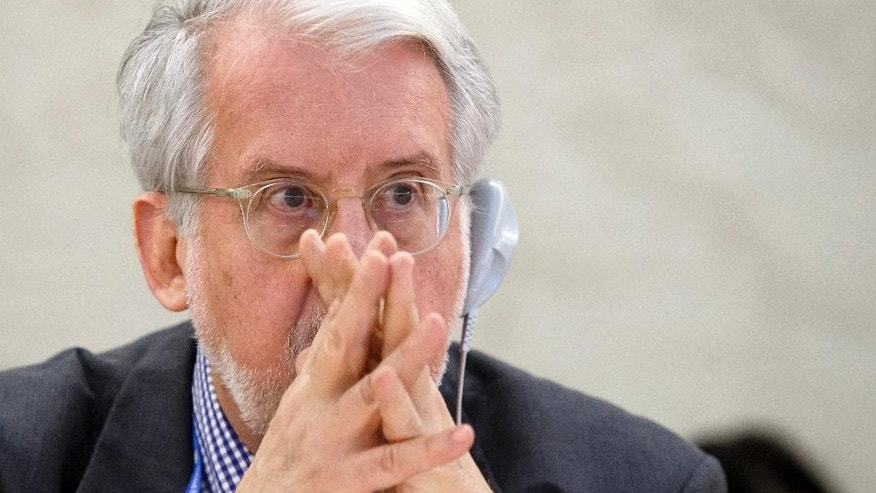 Brazilian Paulo Pinheiro, Chairperson of the Commission of Inquiry on Syria, listens to a speech after his presentation of the commission's last report on Syria at the Human Rights Session at the European headquarters of the United Nations in Geneva, Switzerland, Tuesday, Sept. 16, 2014. Pinheiro, told the U.N.'s top human rights body that the government's killing of civilians — often through the use of ubiquitous checkpoints — exceeds the crimes against civilians perpetrated by the militants and other anti-government armed groups. (AP Photo/Keystone, Salvatore Di Nolfi)