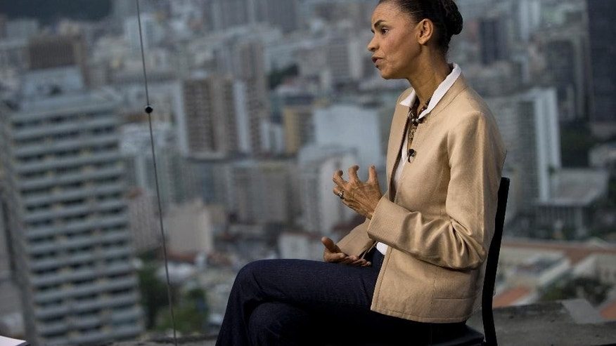 Marina Silva, presidential candidate of the Brazilian Socialist Party, speaks during an interview with AP in Rio de Janeiro, Brazil, Wednesday, Sept. 17, 2014. Silva was thrust into the Socialist Party's presidential nomination when its candidate of choice, Eduardo Campos, died in a plane crash last month. Since then, her anti-establishment profile has propelled her to a neck-and-neck race with  the actual Brazilian president Dilma Rousseff. Silva says that if elected she'll work to repair ties with the U.S. damaged by American espionage in Brazil. (AP Photo/Silvia Izquierdo)
