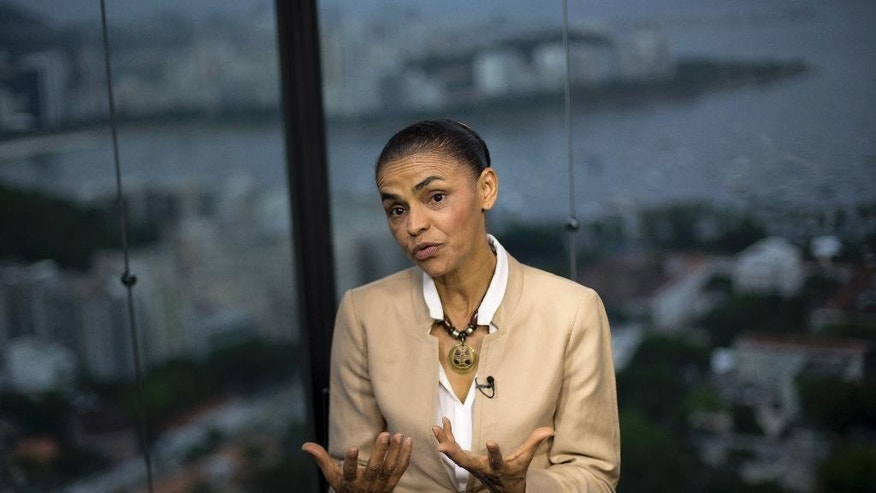 Marina Silva, presidential candidate of the Brazilian Socialist Party, speaks during an interview with AP in Rio de Janeiro, Brazil, Wednesday, Sept. 17, 2014. Silva was thrust into the Socialist Party's presidential nomination when its candidate of choice, Eduardo Campos, died in a plane crash last month. Since then, her anti-establishment profile has propelled her to a neck-and-neck race with actual Brazilian president Dilma Rousseff. Silva wants Brazil to be a global leader in human rights and the environment and that she'll underscore her personal commitment to human rights with regimes like Cuba, where she says a transformation to a democratic regime is possible. (AP Photo/Silvia Izquierdo)