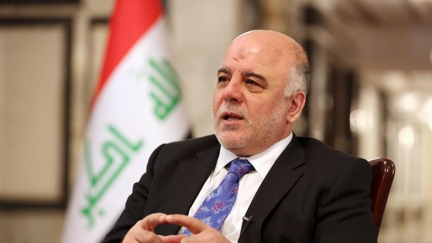 Iraq's Prime Minister Haider al-Abadi speaks during an interview with The Associated Press in Baghdad, Iraq, Wednesday, Sept. 17, 2014. Iraq's new prime minister says foreign ground troops are neither necessary nor wanted in his country's fight against the Islamic State group. (AP Photo/Hadi Mizban)